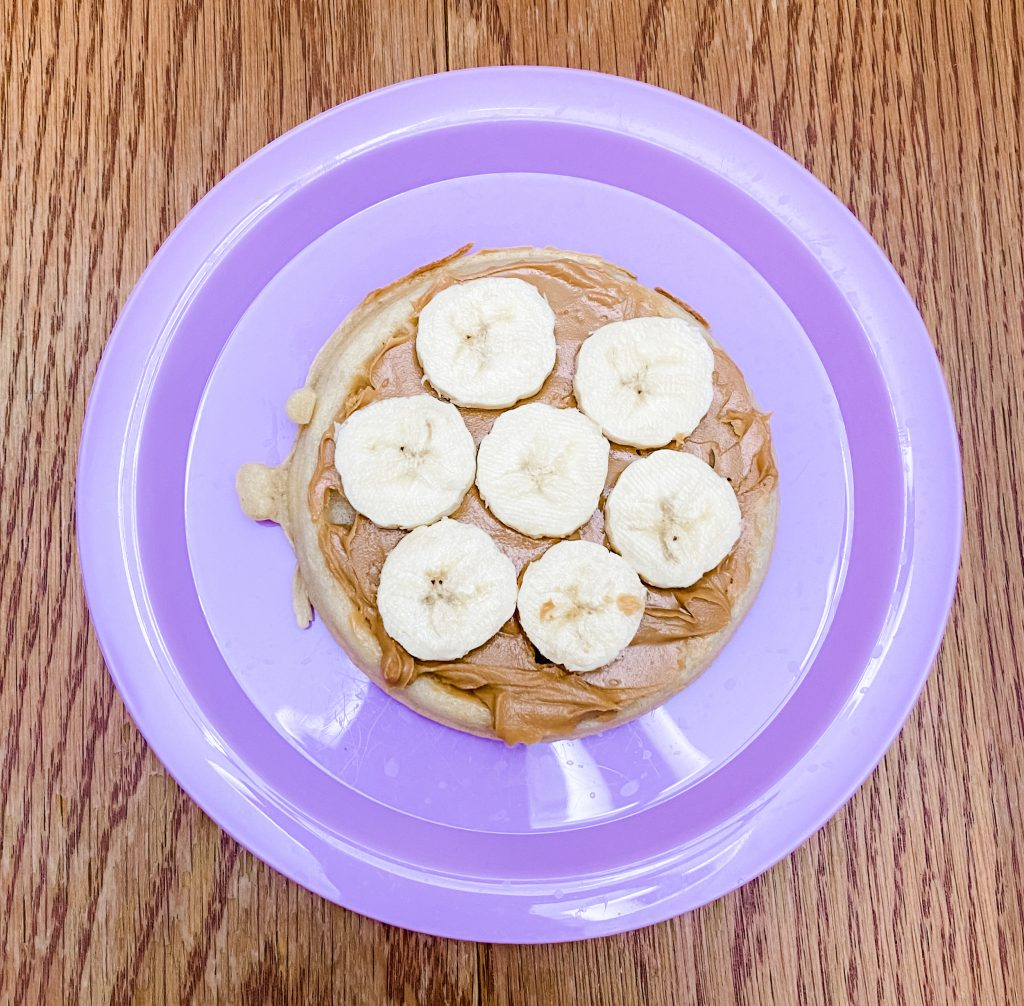 Waffle with peanut butter and banana slices